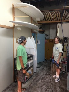 Tom Parrish with Tim Stamps at Stamps Surfboards in August 2013.