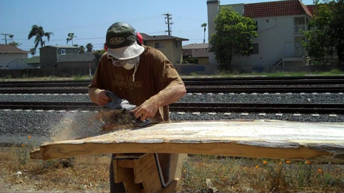 Gary working with his preferred surfboard medium, Balsa wood.